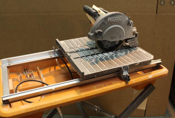 Check the functions on the wet tile saw